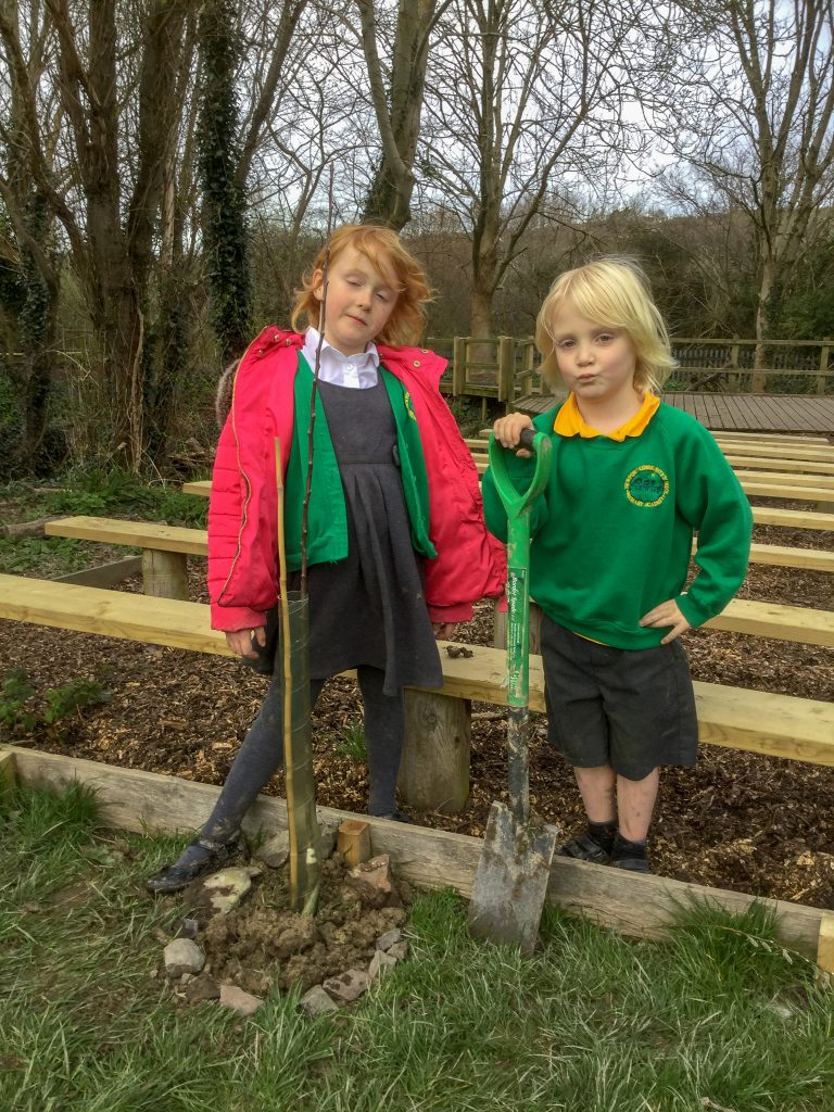 Two children from Newport Community Primary stand with shovels at the ready