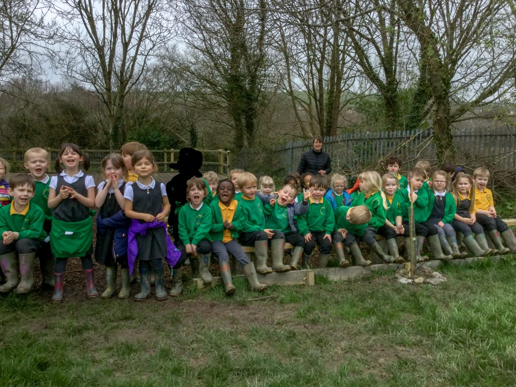 Children from Newport Community Primary plant their first tree